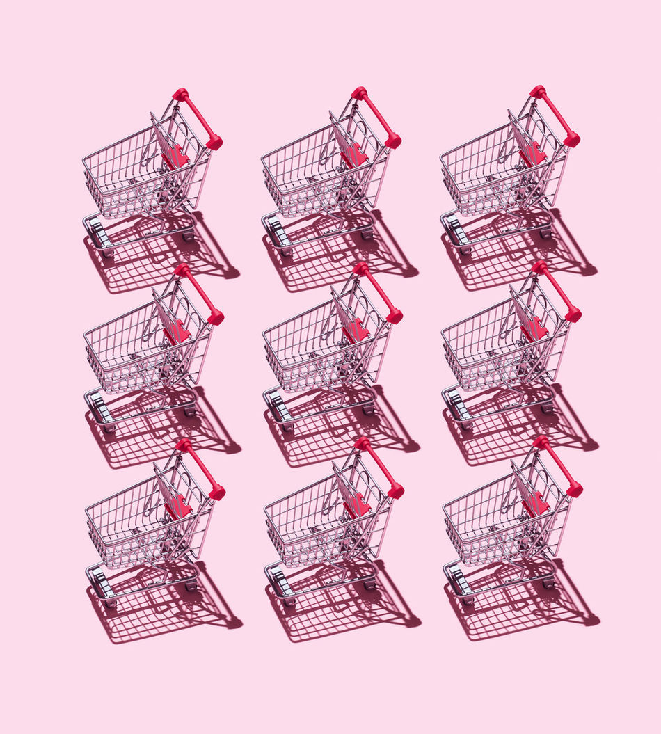 Multiple Shopping Carts organized over pink background Basket Cart Commerce Commercial Concept Conceptual Harsh Shadow Market Organized Organized Neatly Pattern Purchase Sale Shopping Shopping Cart Supermarket Things Organized Neatly Trolley