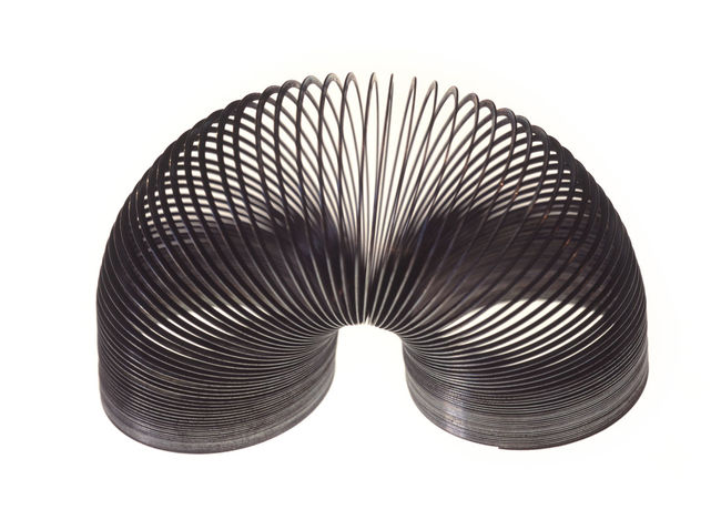 metal retro slinky toy Circle Coil Coiled Ideas Metal Retro Shape Shape Shapes Simplicity Single Object Slinkey Slinky  Spring Springly! Steel Toy Wire