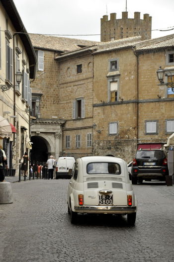 Architecture Building Built Structure City City Life City Street Day Land Vehicle Mode Of Transport No People Orvieto, Italy Outdoors Parked Parking Residential Building Road Sky Stationary Travel Destinations