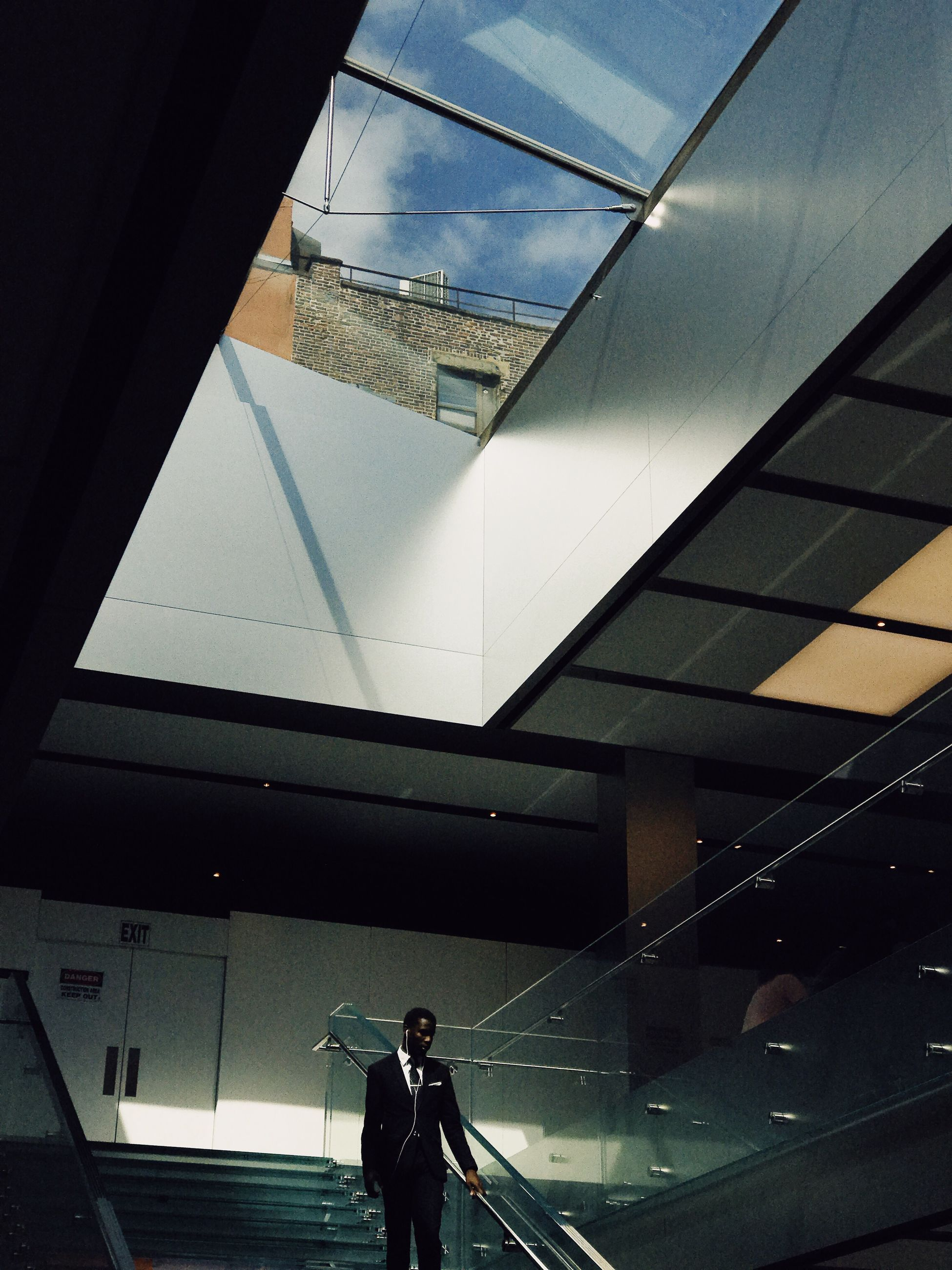 real people, architecture, one person, built structure, reflection, indoors, lifestyles, window, standing, women, men, young adult, day, low angle view, young women, illuminated, building exterior, sky, people