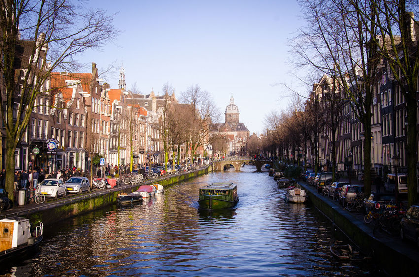 Amsterdam Canal in January. Amsterdam Amsterdam Canal Amsterdam Centraal Amsterdamcity Architecture Bare Tree Bike Boat Bridge Building Exterior Built Structure Canal City Neon Lights Night Outdoors Red Light District Reflection River Riverside Tourism Travel Destinations Tree View Water