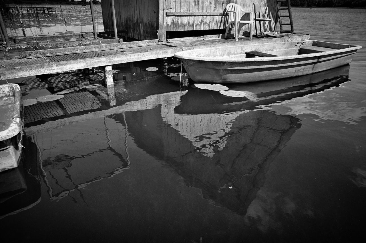 reflection, water, nautical vessel, moored, mode of transport, day, waterfront, transportation, no people, outdoors, puddle, nature