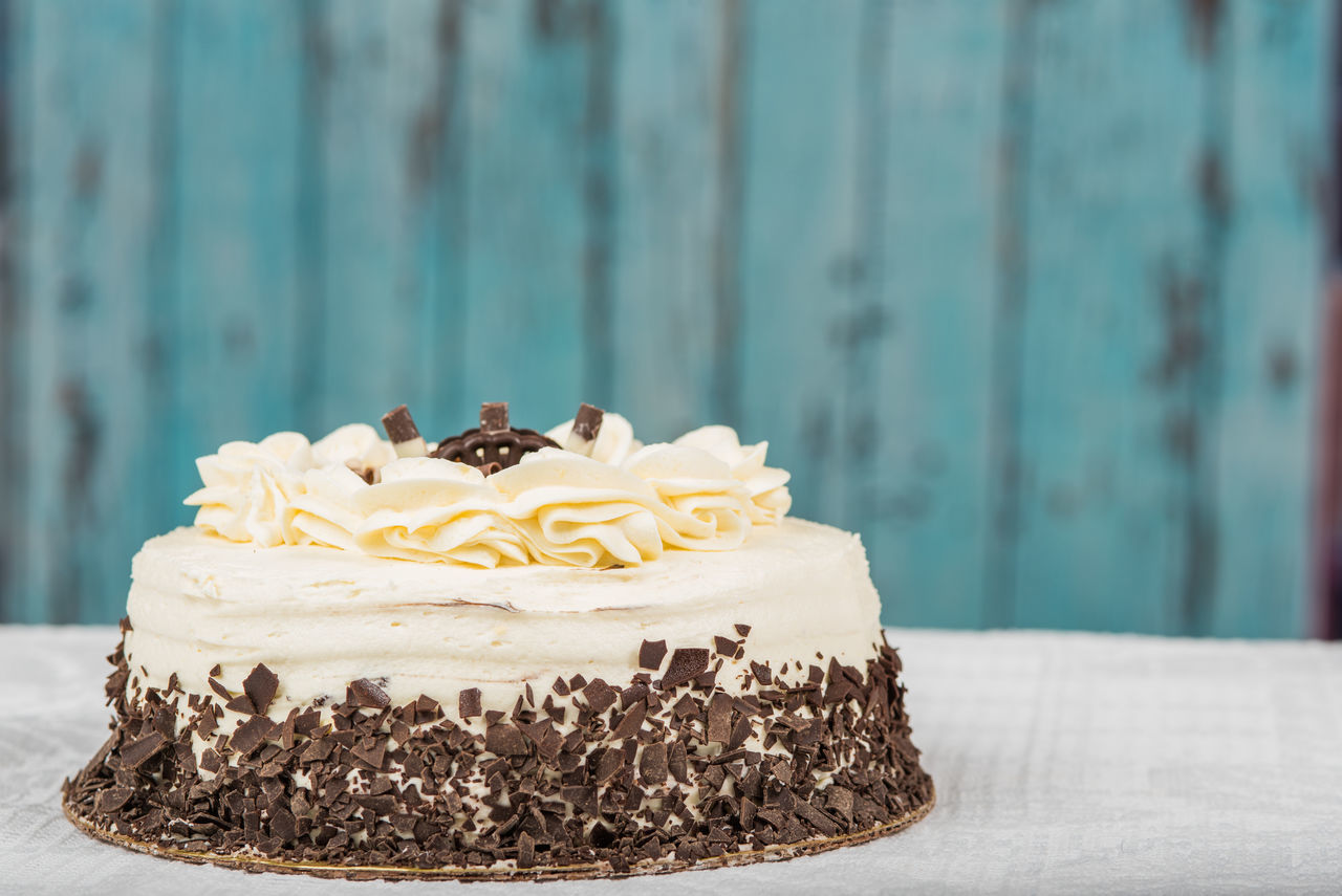White frosted cake with chocolate pieces Anniversary Birthday Cake Cake Celebration Dessert Food Food And Drink Indulgence Life Events No People Sweet Food Temptation Wedding Cake