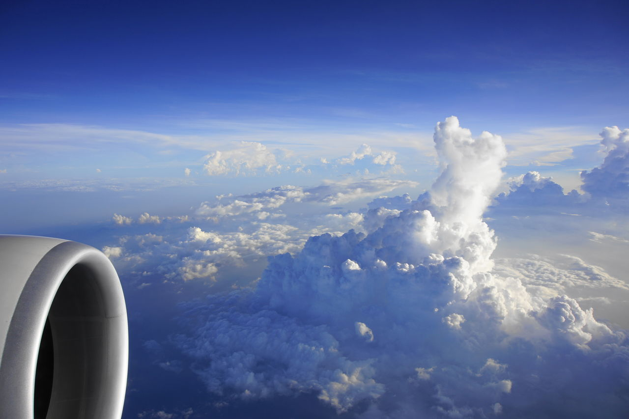 cloud - sky, sky, nature, airplane, beauty in nature, blue, air vehicle, day, scenics, outdoors, mid-air, no people, aerial view, flying, airplane wing