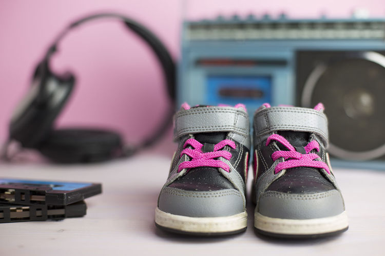 80s Baby Black Color Children Close-up Day Fashion Focus On Foreground Footwear Gray Hat Headphones Lifestyles Little Girl Pair Part Of Pink Radio Schoes Selective Focus Sneakers Still Life Style Tapes Velcro