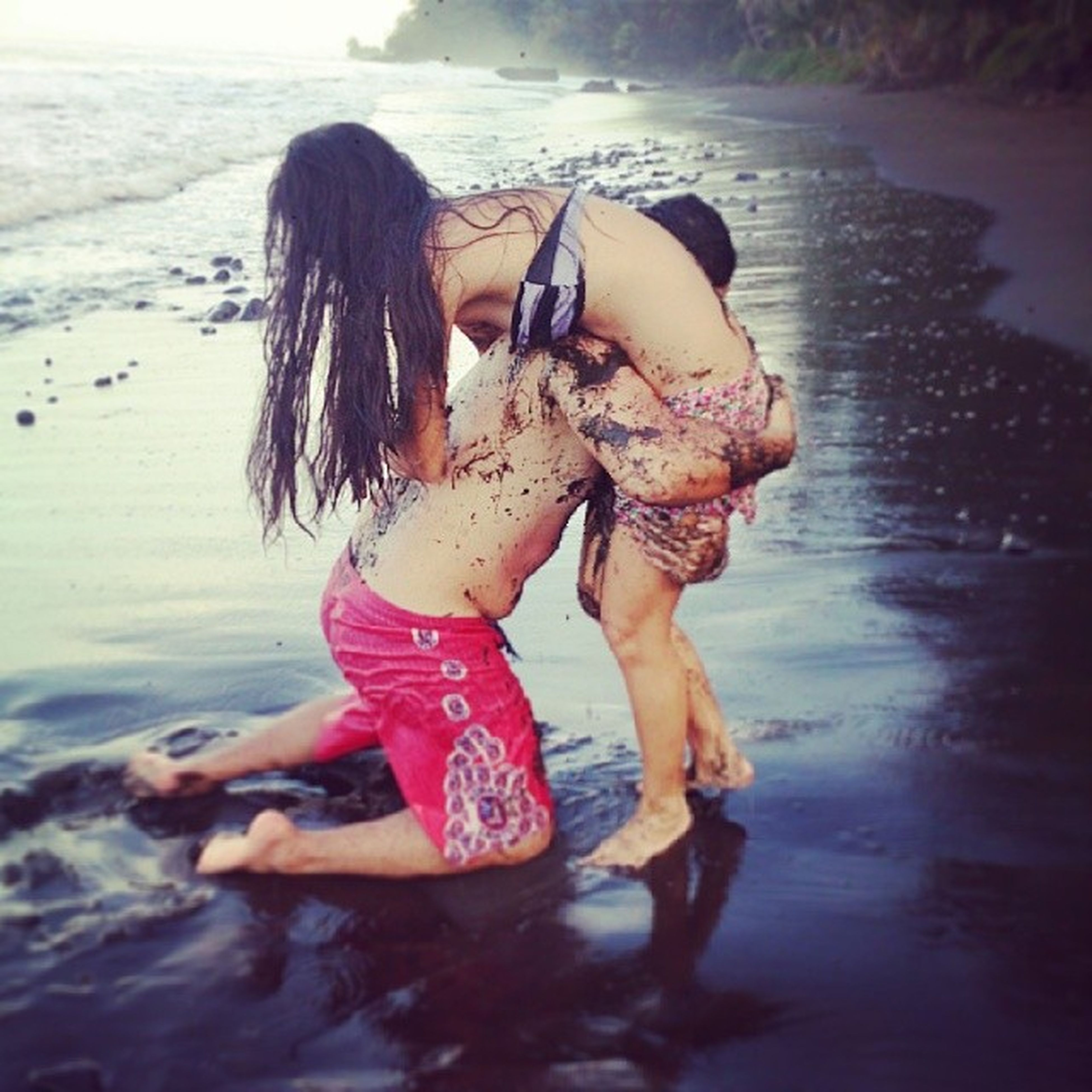 water, lifestyles, leisure activity, sea, full length, beach, girls, shore, vacations, casual clothing, childhood, person, rear view, young women, young adult, enjoyment, togetherness, elementary age
