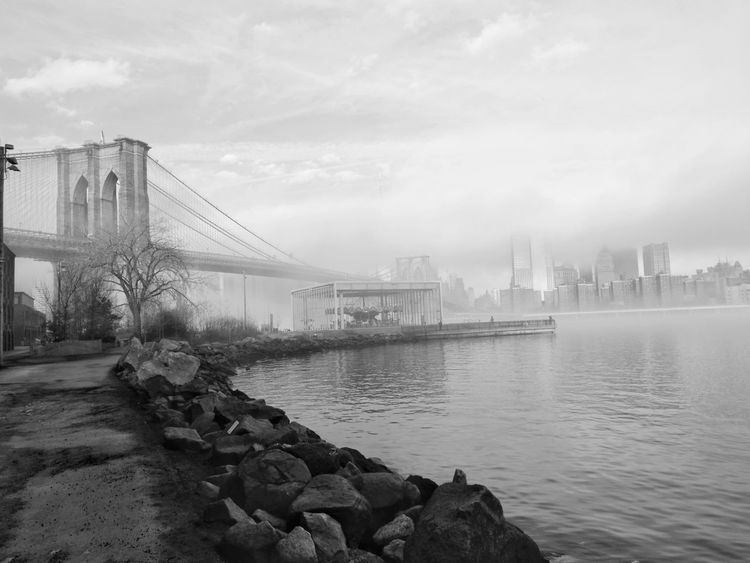 Monochrome Check This Out Runners Manhattan Bridge New York City The City Light Architecture Water Cloud - Sky Foggy Morning Fog Rocks Rocks And Water Brooklyn Reflections Travel Destinations No People Check This Out!