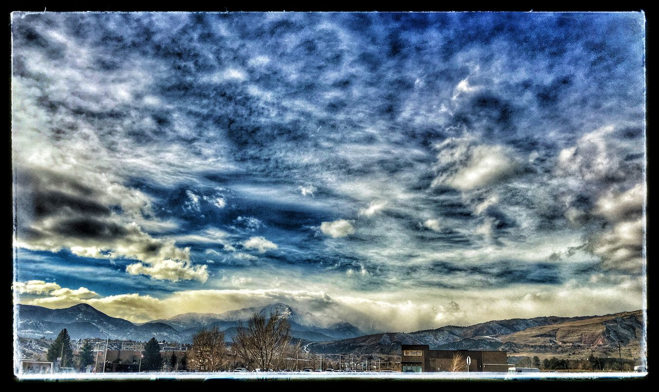 Today at lunch the sky was lovely. Full of clouds, cool air and fresh pleasure to feel and see. Pikes Peak was cloudy covered. Edited in Snapseed with drama and some punch to the sky. Colorado Springs, CO IPhoneography Apple Camera IPhone 6s Plus Cloudy Day Chilly Day Winter 2015 Brrr Out Mobile Photography EyeEm Mountain Shot Shot With A IPhone EyeEm Winter Shot