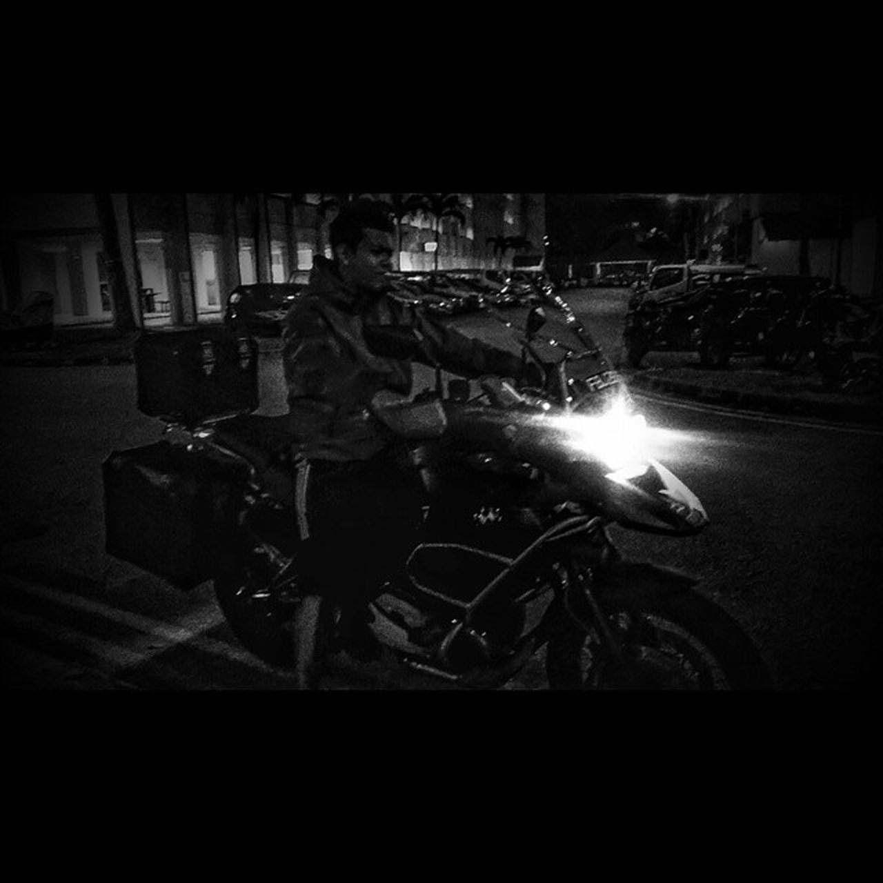 illuminated, night, real people, one person, motorcycle, lifestyles, standing, leisure activity, technology, mobile phone, helmet, full length, holding, wireless technology, photographing, indoors, photography themes, men, young adult, biker, close-up, adult, people