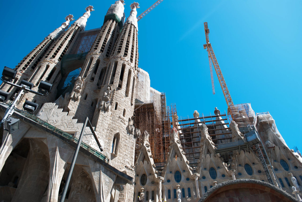 Architecture Building Exterior Built Structure Business Finance And Industry City Day Industry Low Angle View No People Outdoors Pilgrimage Religion Sagrada Familia Sagradafamilia Sky Travel Destinations Urban Skyline