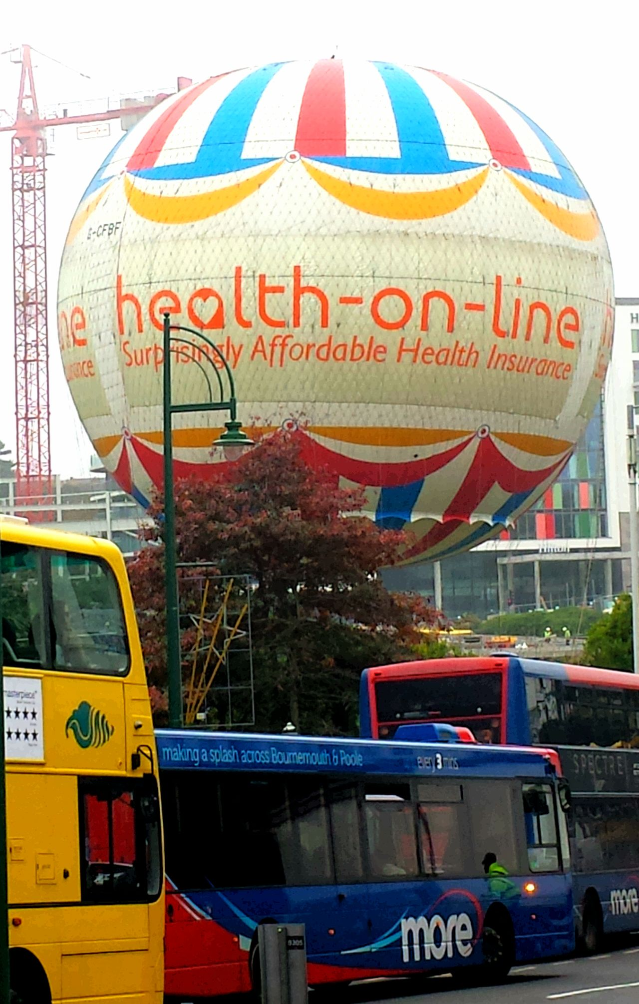 Balloon Advertising Health-on-line Buses Crane Outdoors Busy Road Bournemouth England 🌹 Samsung Galaxy S4 Flying High Flying Low