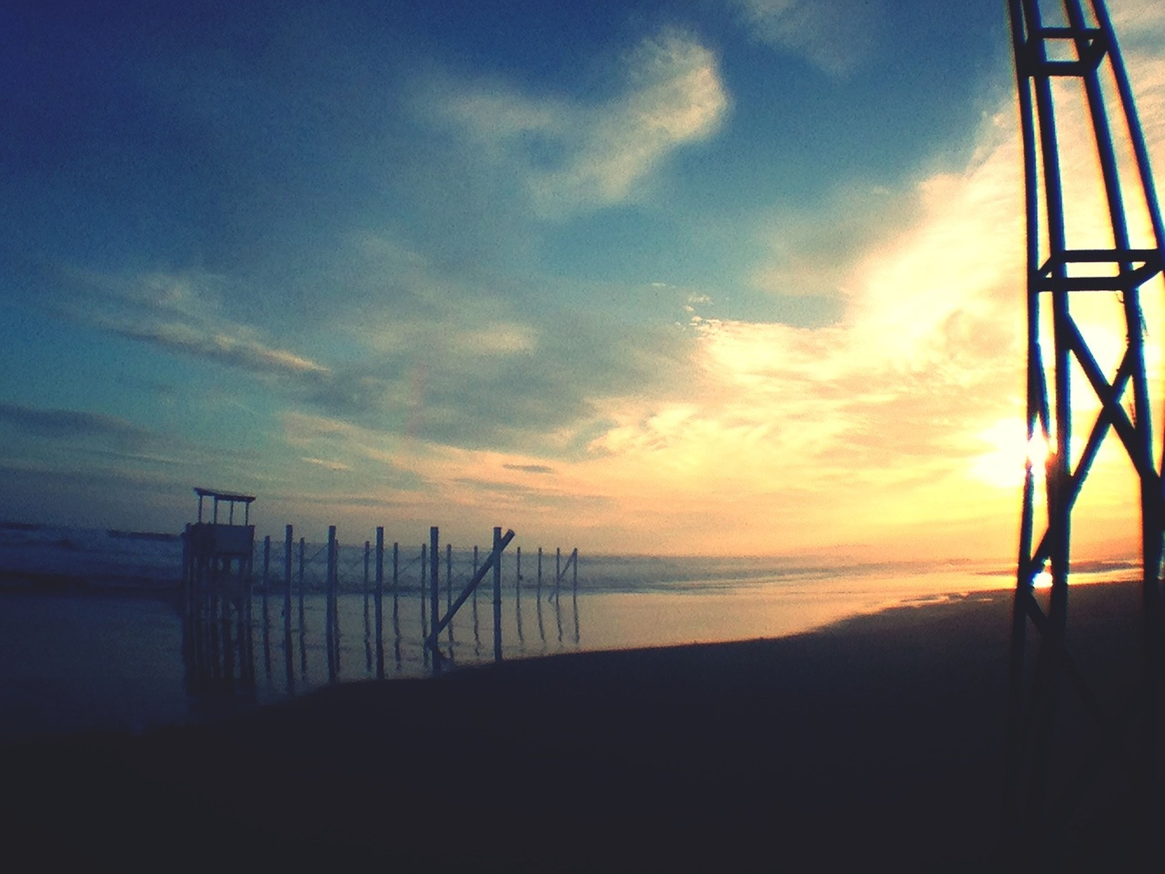 sea, sunset, horizon over water, sky, water, tranquility, silhouette, tranquil scene, scenics, beach, beauty in nature, nature, shore, idyllic, cloud - sky, cloud, calm, remote, outdoors, non-urban scene