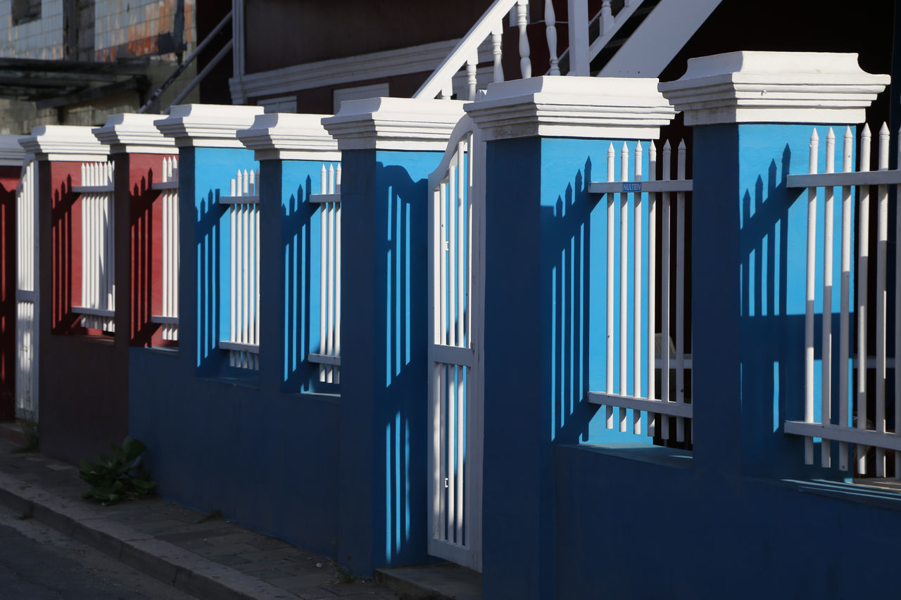 in a row, architecture, built structure, multi colored, no people, day, outdoors, building exterior