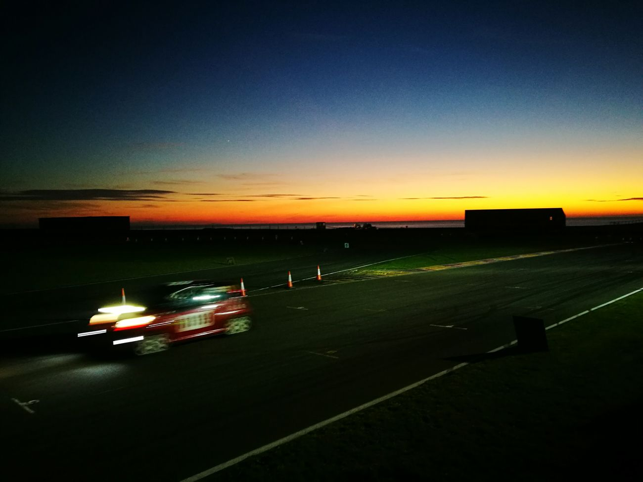 Sunset Outdoors Sky Night Motorsport Rally Car Rally Motion Blur Beauty In Nature Nature Scenics No People Nautical Vessel