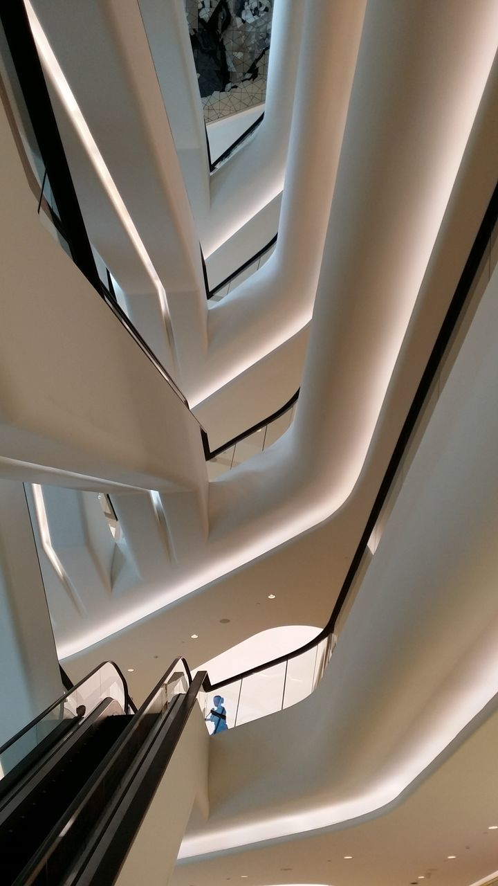 low angle view, steps and staircases, ceiling, indoors, staircase, architecture, built structure, no people, illuminated, modern, architectural design, day, hand rail, close-up