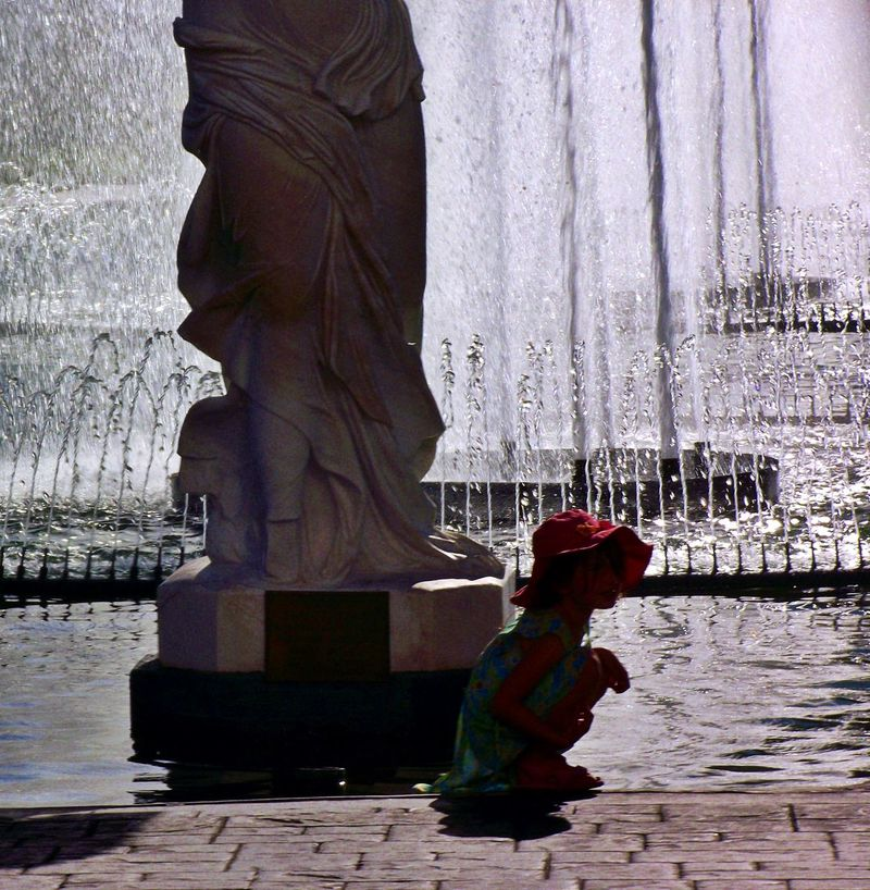 Red Hat Statue Fountain Waterscape Water City Life Street Photography Child Purity Playing Exploring New Ground Here Belongs To Me Nevada Cityscape Essence Of Summer Original Experiences