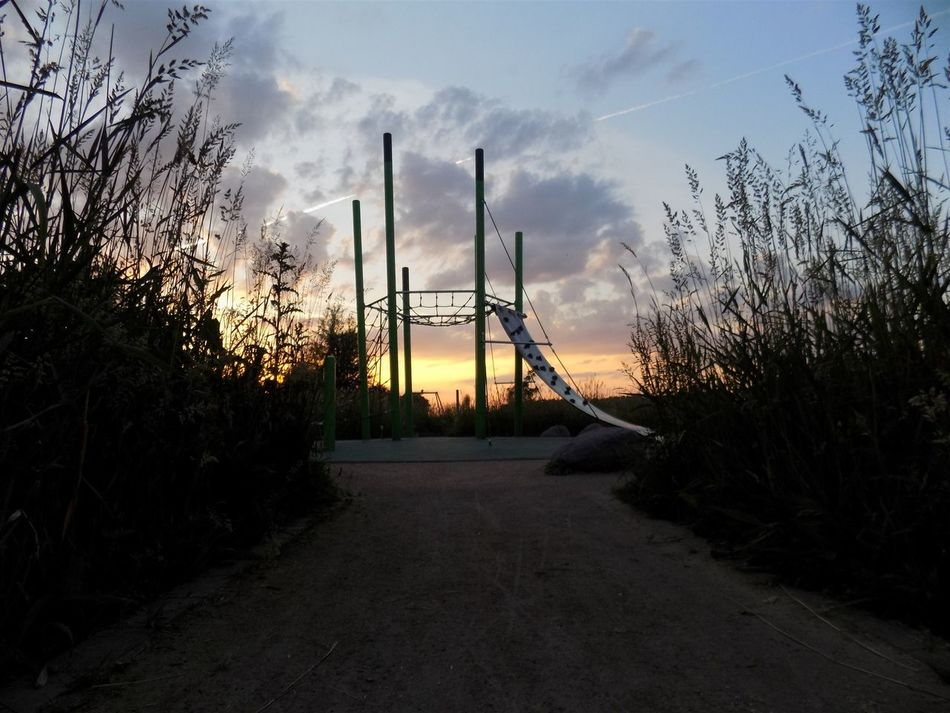 Sunset on my favourite playground last summer Sunset Sky Cloud - Sky Nature Playground Summer Tranquil Scene Low Angle View Landscape Grass Outdoors Field The Way Forward Diminishing Perspective
