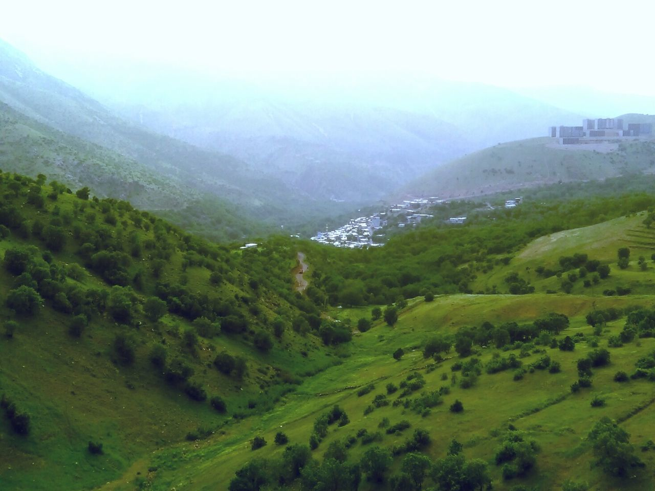 mountain, nature, landscape, beauty in nature, scenics, no people, green color, tranquil scene, tranquility, tree, day, mountain range, outdoors, fog, sky