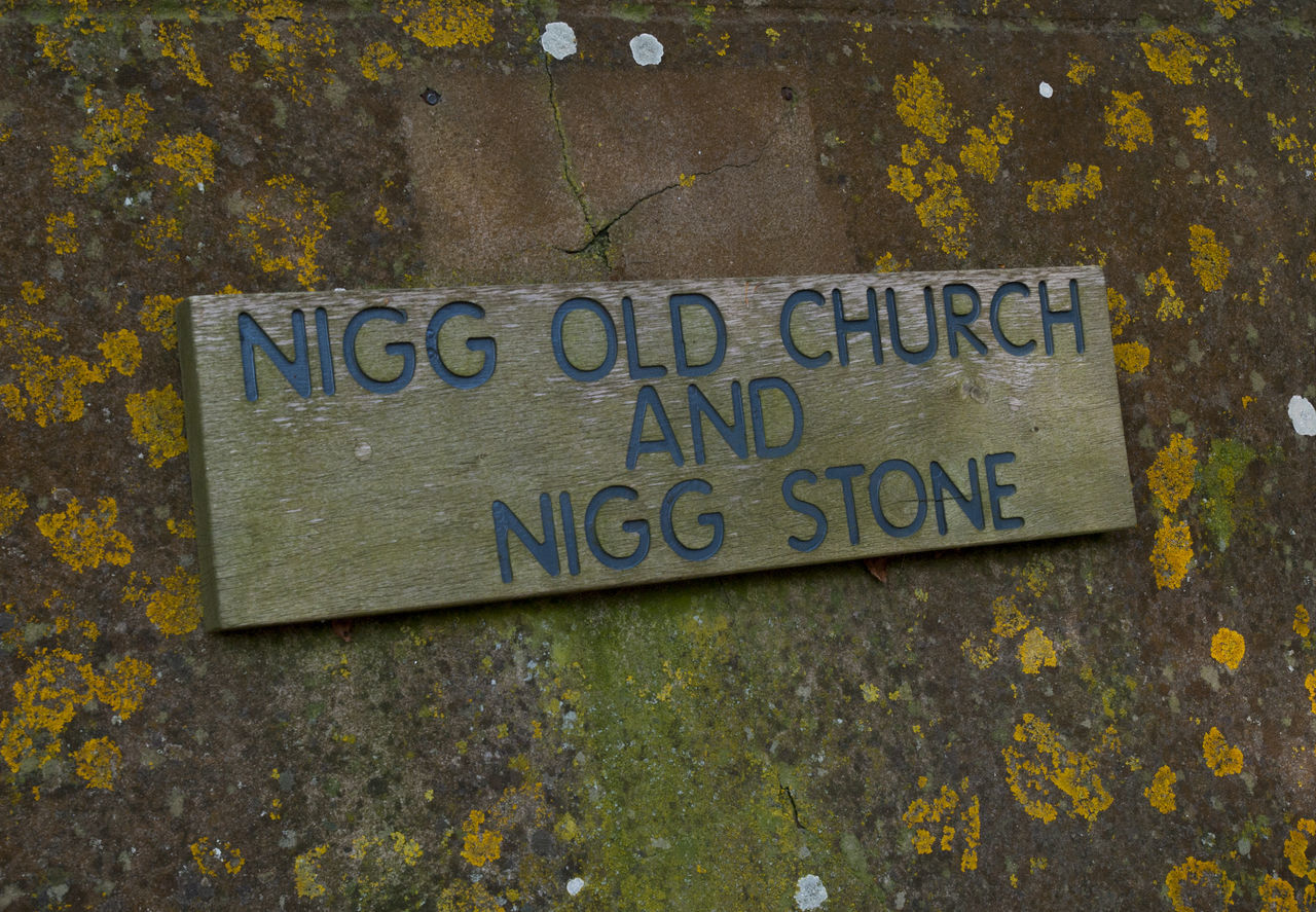 "Nigg (from the Scottish Gaelic: An Neag meaning ""the notch"", referring to a feature of the hills above the parish church) is a village and parish in Easter Ross, administered by The Highland Council.The present parish church is an 18th-century building on an early Christian site dating back to at least the 8th century. The Nigg Stone, one of the most elaborate stone monuments of early medieval western Europe, is preserved in a room at the west end of the church. This late 8th century Pictish cross-slab formerly stood in the churchyard, but was moved indoors for preservation in recent years. 8th Century AD Christian Close-up Communication Day Geometric Shape High Angle View Moray Firth Nigg Nigg Old Church Nigg Stone No People Oil Fabrication Yard Oil Platform Outdoors Rectangle Scotland Scottish Scottish Highlands Text Tour Tourism Travel Travel Destinations Western Script"