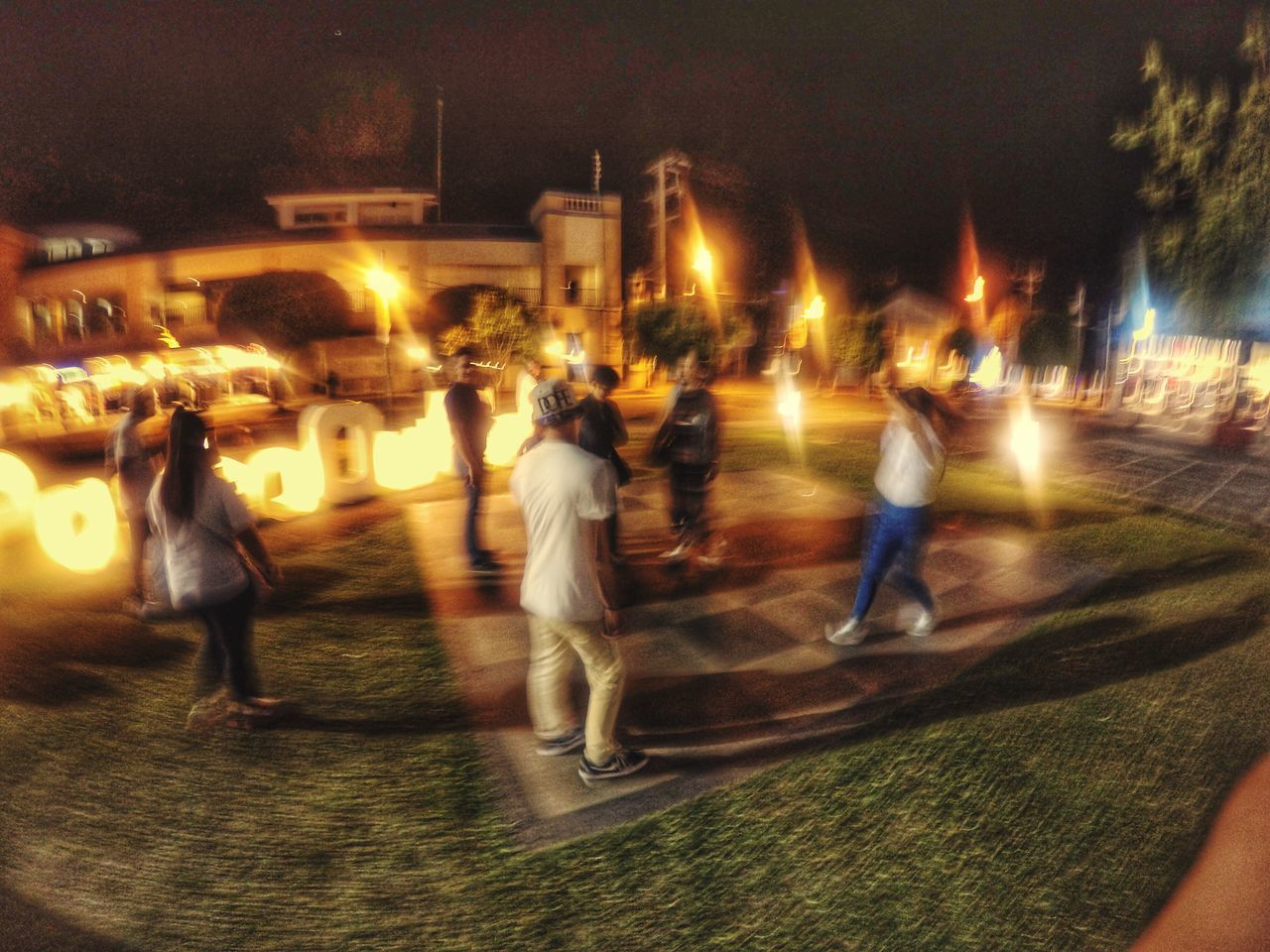 blurred motion, night, real people, motion, illuminated, speed, men, leisure activity, long exposure, lifestyles, large group of people, sport, architecture, built structure, outdoors, women, building exterior, full length, city, sky, people