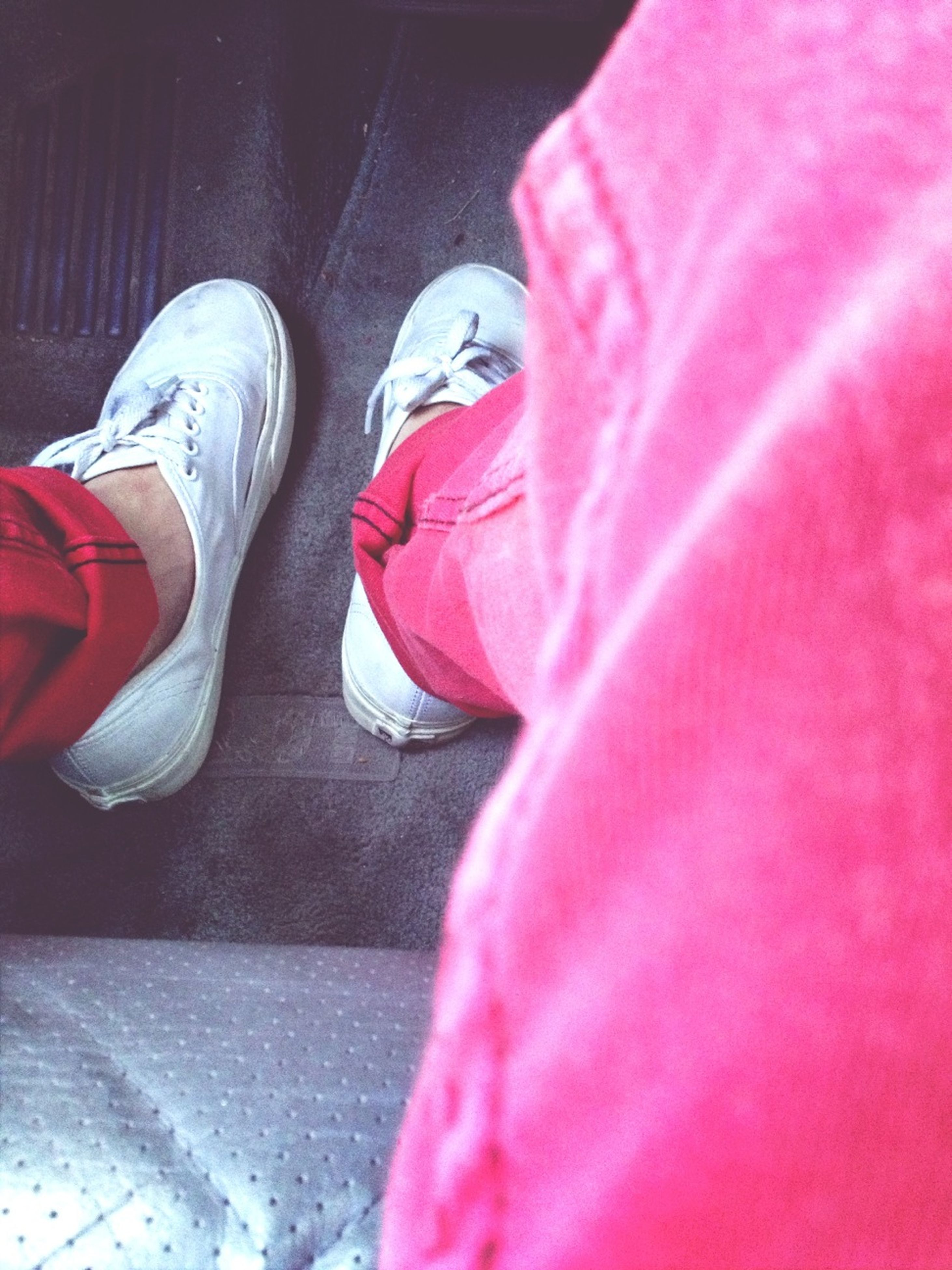 pink color, low section, shoe, red, clothing, person, indoors, fabric, close-up, footwear, textile, relaxation, standing, jeans, multi colored, day, selective focus, rear view