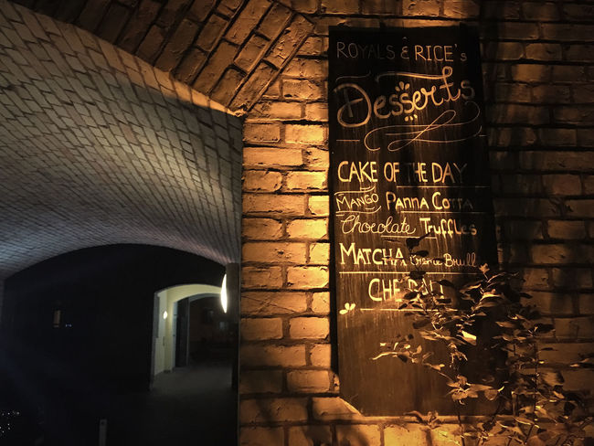 Architectural Feature Architecture Brick Brick Wall Built Structure Hinterhof Illuminated Royal And Rice Sign