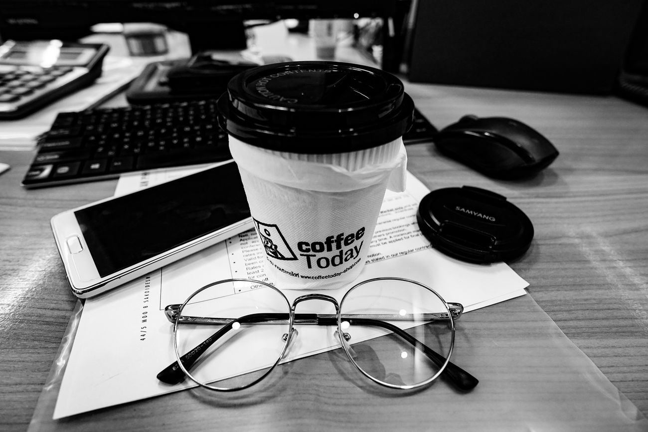 How do you start your day? At Work Close-up Coffee Coffee Cup Coffee Time Computer Keyboard Day Drink Glassses  Hot Drink Indoors  Journalism Mobile Phone No People Office Officelife Offiece Paper Startup Technology Work