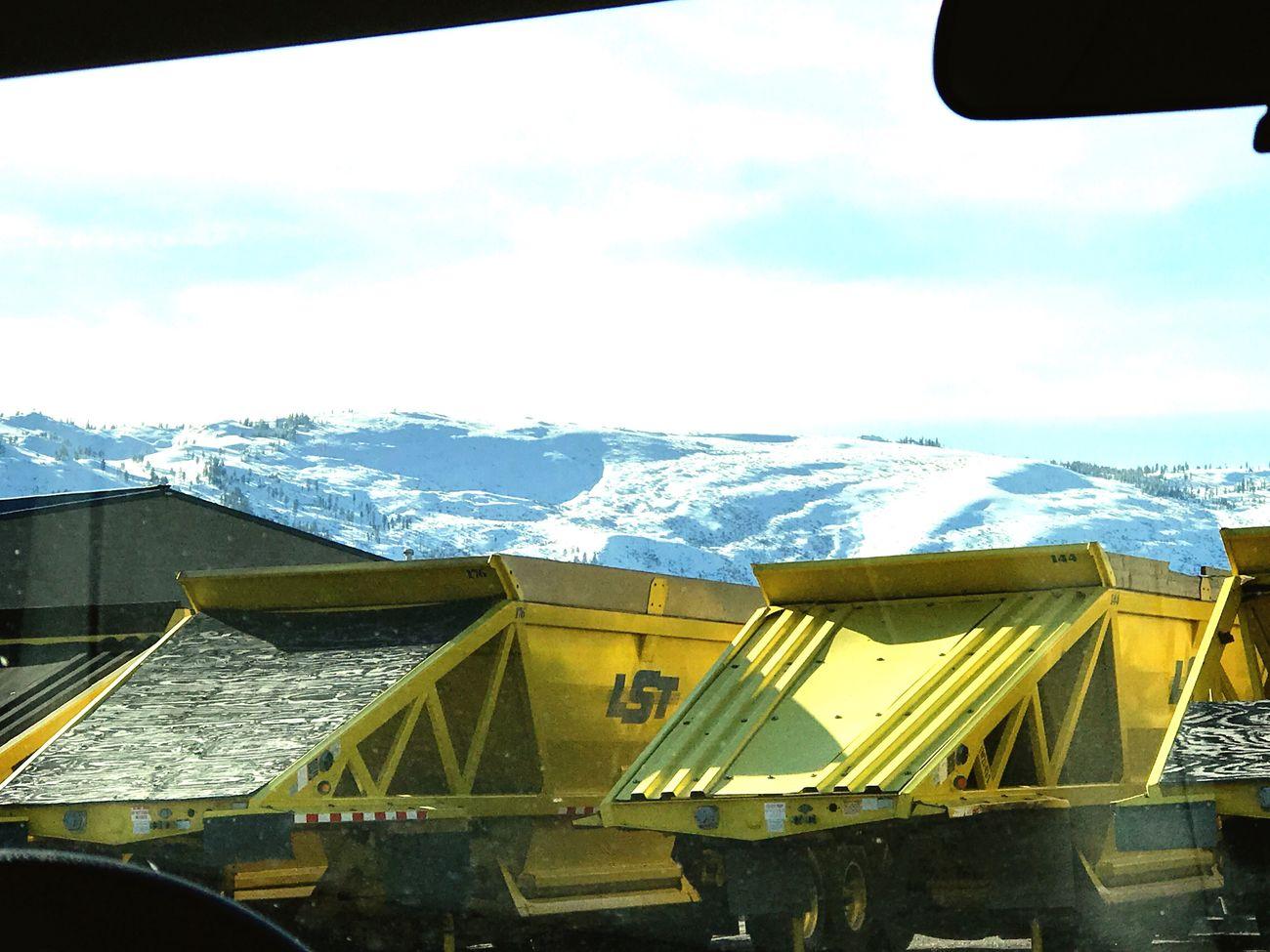 Snow Trucks Carrying Snow Mountain