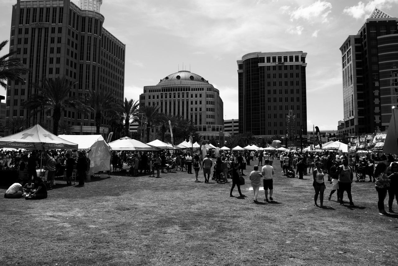 Summer is here and it's time for Streetphotography Festival Season Large Group Of People City Crowd People Building Exterior Travel Destinations Outdoors Day Orlando Blackandwhite Leonidas Downtown Street City Building Florida Skyscraper Urban Skyline Sky
