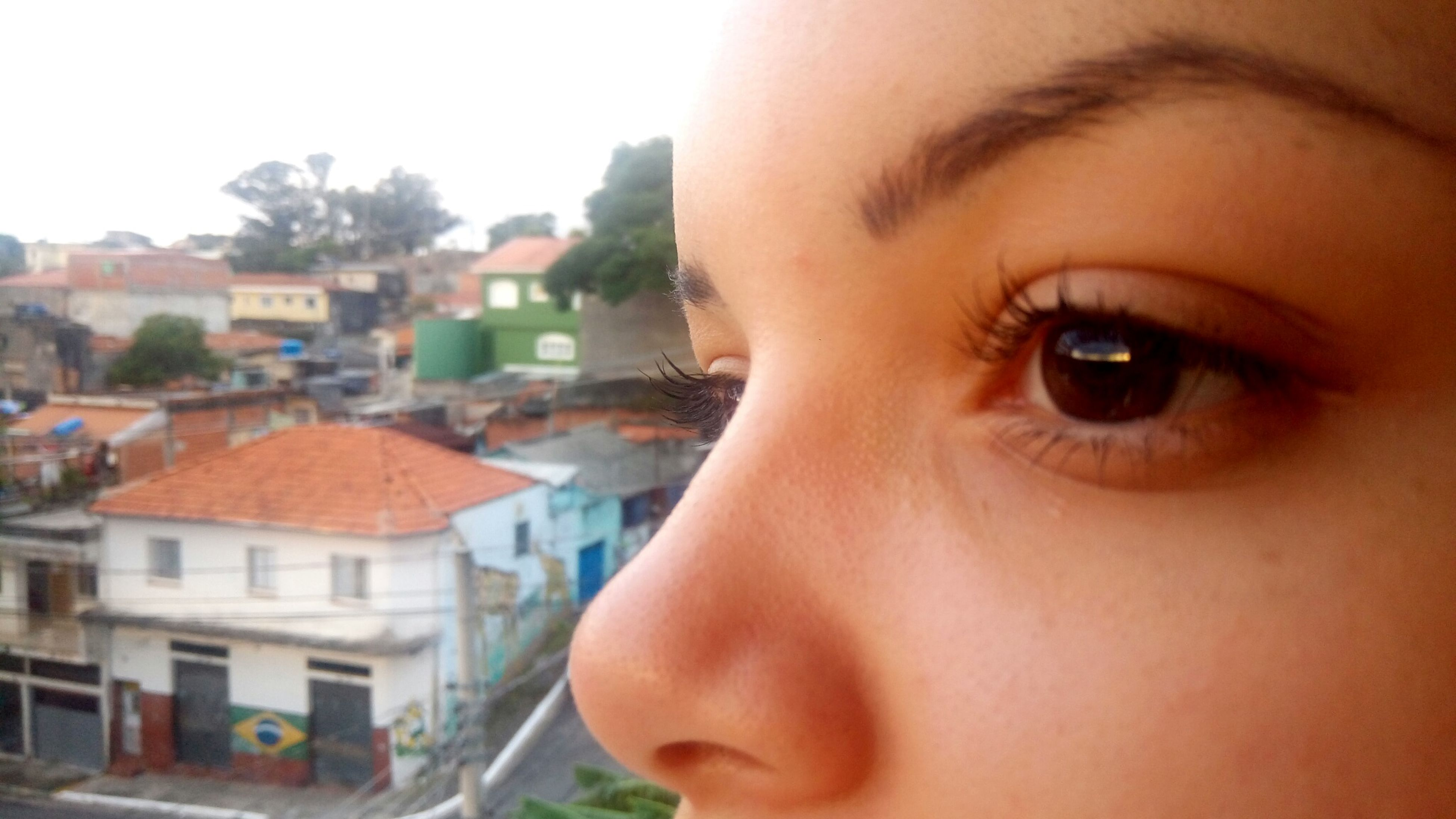 real people, human face, one person, close-up, beautiful woman, lifestyles, outdoors, building exterior, women, young women, portrait, day, beauty, young adult, eyelash, city, mascara, architecture, human eye, sky