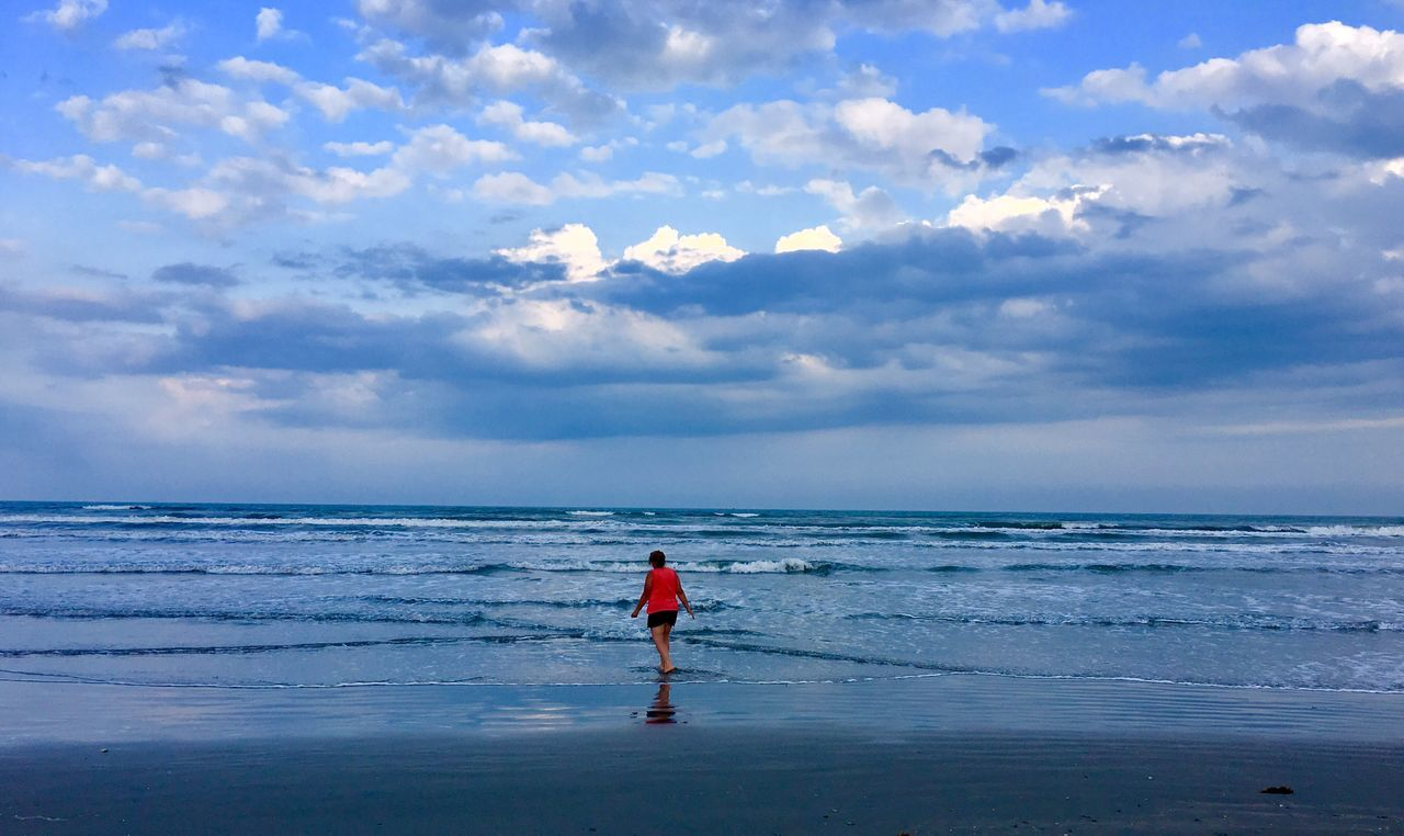 Live For The Story Sea Horizon Over Water Sky Water Cloud - Sky Nature Scenics Beauty In Nature Full Length Beach One Person Tranquility Tranquil Scene Day Outdoors Standing Real People Beach Life Blue Beach Day Beach Walk