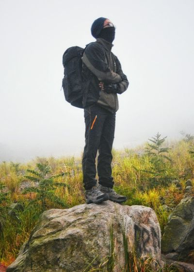One Man Only Standing Only Men Fog Men Sky Cold Temperature Grass Outdoors Warm Clothing Young Adult Travel Destinations Misty Morning Misty Mountains  Adventure Mountain Track Landscape Wanderlust Wanderer Bacpacker Freshness Wild Nature Mountain Beauty In Nature