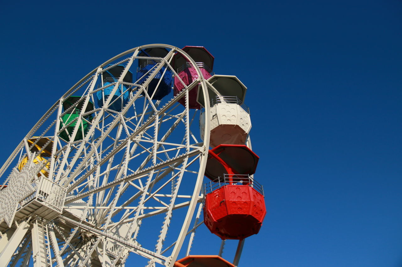 clear sky, low angle view, arts culture and entertainment, amusement park, blue, ferris wheel, outdoors, day, no people, amusement park ride, sky