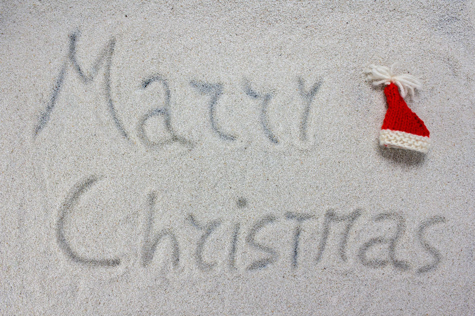 ed Christmas hats and Merry Christmas written on the white snow Background Celebration Christmas Claus December Decoration Festive Holiday Merry Santa Sky Snow White Winter Xmas