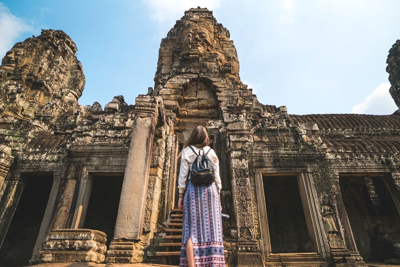 Scale is relative Architecture Travel Destinations Religion Built Structure Tourism Building Exterior Old Ruin Travel Spirituality History Ancient Civilization Vacations Outdoors Day People Adult Cambodia Wonder Of The World ASIA Real Life Temple Showcase May Culture One Person One Woman Only