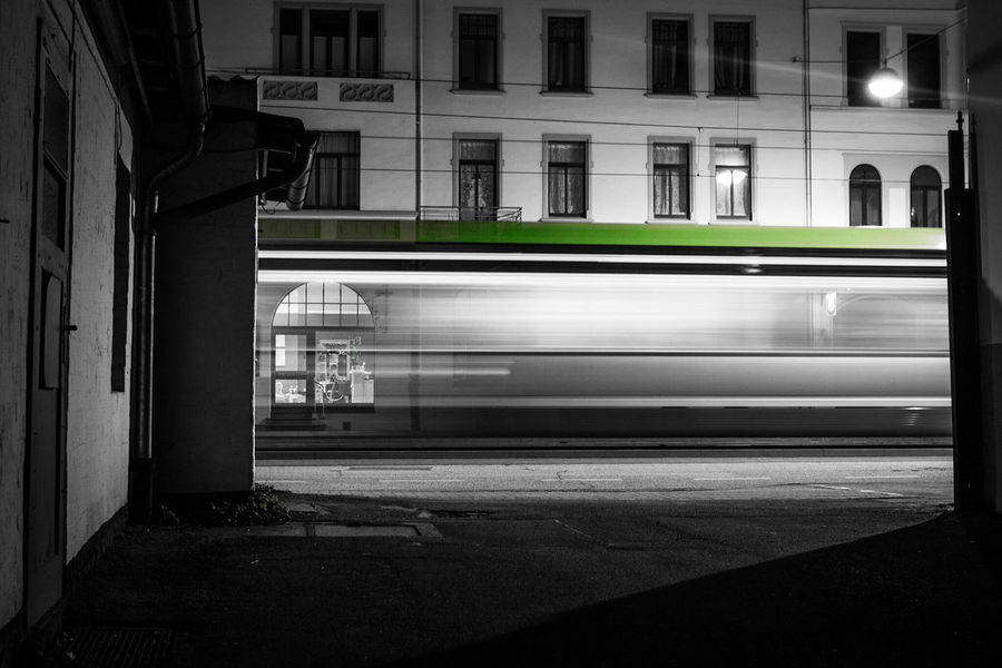 "~ [ The 1'3"" Moments of the Night] - Into the Light ~ Night Architecture Built Structure No People Long Exposure Getting Inspired Light And Shadow Monochrome Canon Outdoors Streetphotography Lines And Shapes Black & White Colorsplash Green Color Velocity Train Blurred Motion Street Photography Shadow City Life City Night Lights Light Trails EyeEm Best Shots Mobility In Mega Cities"
