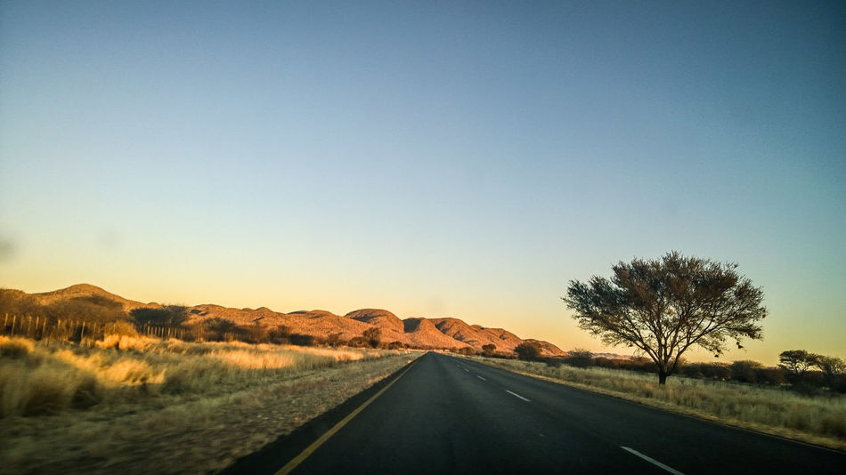 Africa Beauty In Nature Clear Sky Day Freedom Landscape Mountain Namibia Nature No People Okahandja On The Road Outdoors Road Road Roadtrip Sky The Way Forward Tranquility Transportation Tree
