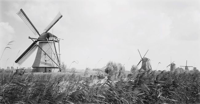 Wind Power Windmill Environmental Conservation Alternative Energy Wind Turbine Renewable Energy Fuel And Power Generation Traditional Windmill Rural Scene Built Structure Nature Architecture No People Field Water Pump Sky Industrial Windmill Outdoors Building Exterior Cultures Black And White Monochrome Monochrome Photography