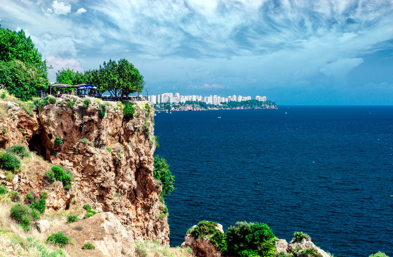 Antalya city. It is biggest international sea resort in Turkey Antalya Turkey ASIA City Cloud - Sky Coast Coastline Horizon Over Water Marine Mediterranean Sea Middle East No People Outdoors Resort Rock Formation Rocky Coastline Sea Seascape Seaside Sunny Day Travel Destinations Turkey Turkish Riviera View