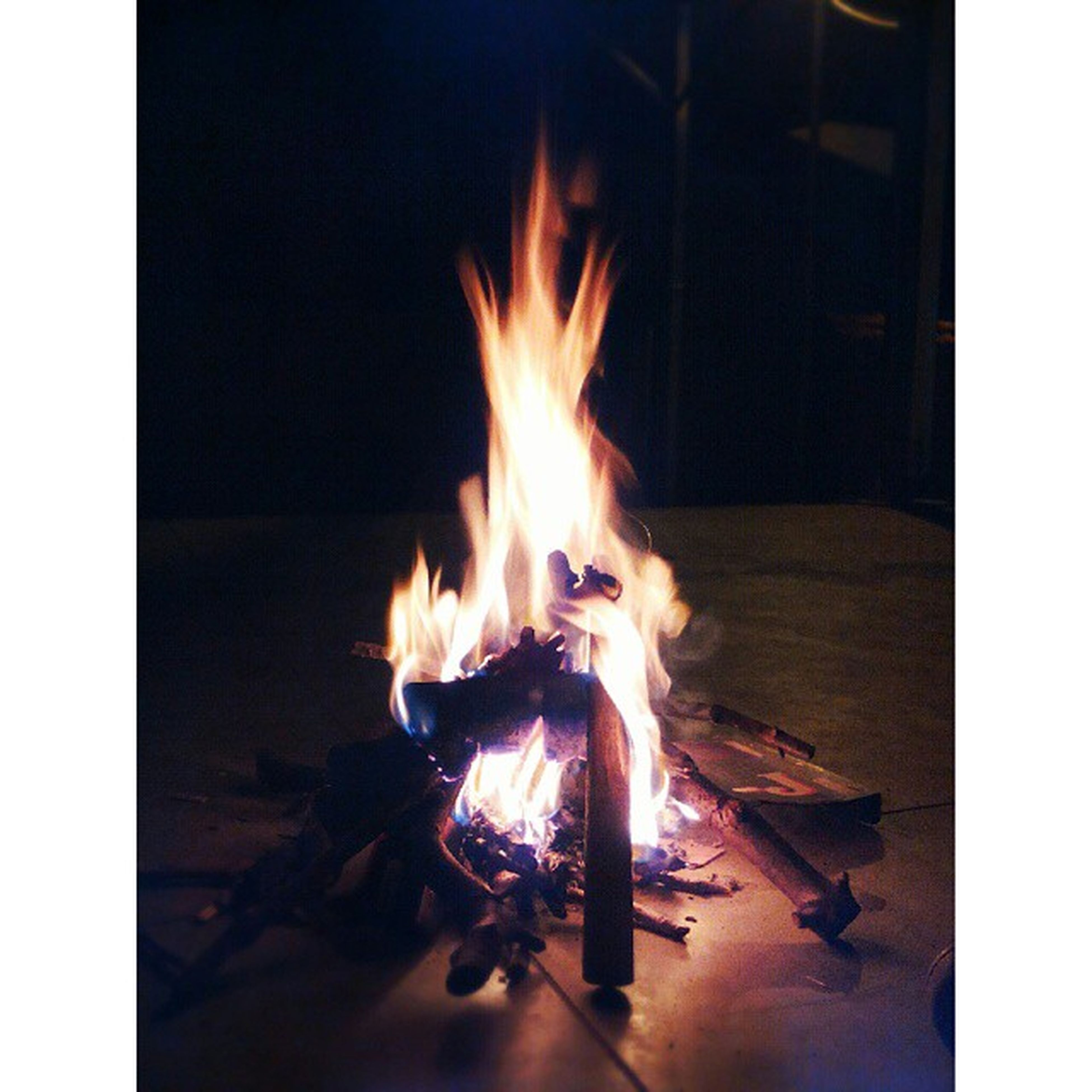 flame, burning, fire - natural phenomenon, heat - temperature, bonfire, transfer print, fire, firewood, heat, glowing, campfire, night, auto post production filter, orange color, indoors, wood - material, dark, illuminated, motion, fireplace