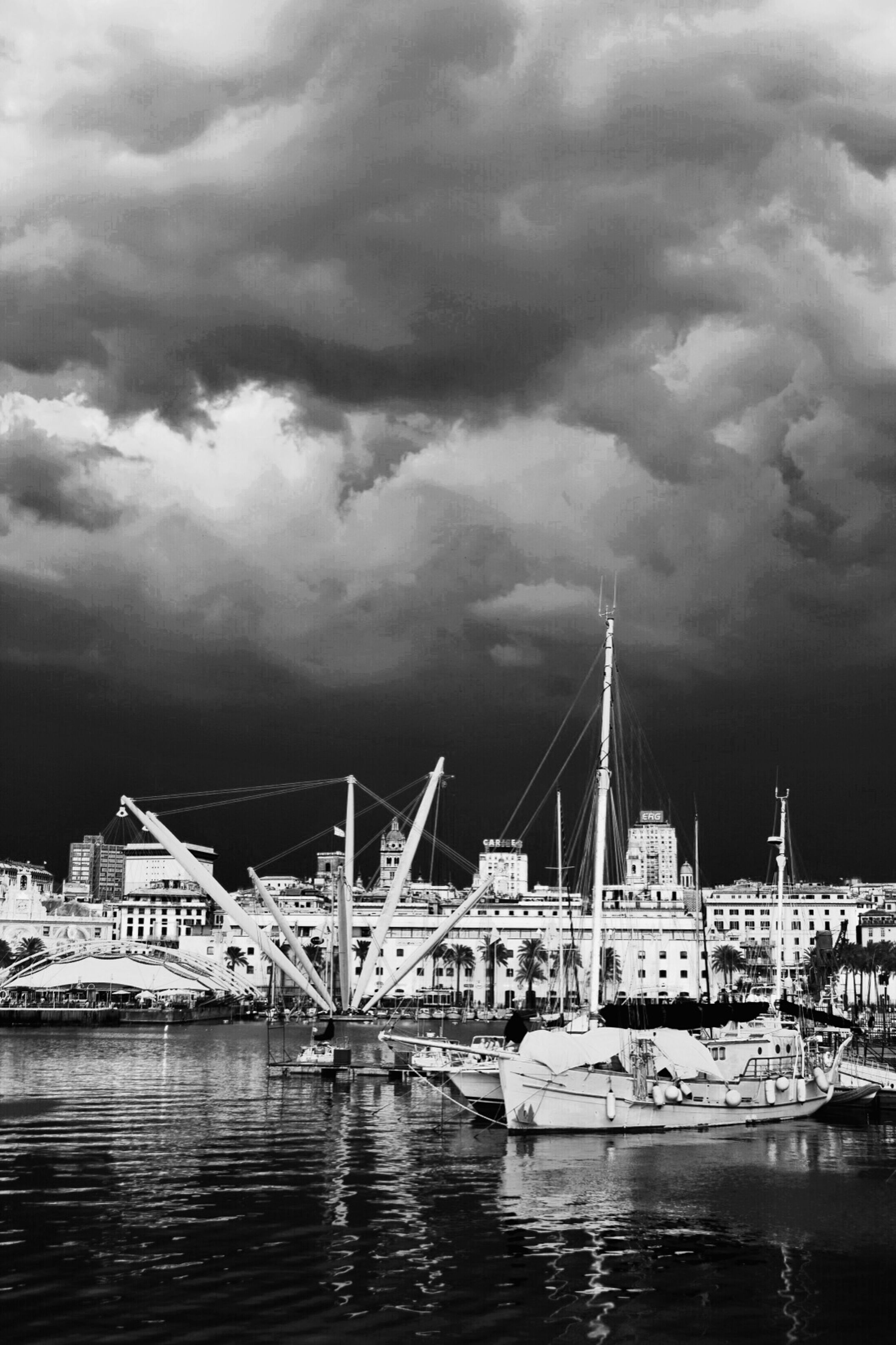 water, waterfront, architecture, built structure, nautical vessel, sky, transportation, cloud - sky, building exterior, mode of transport, cloudy, river, boat, moored, overcast, city, cloud, rippled, weather, bridge - man made structure