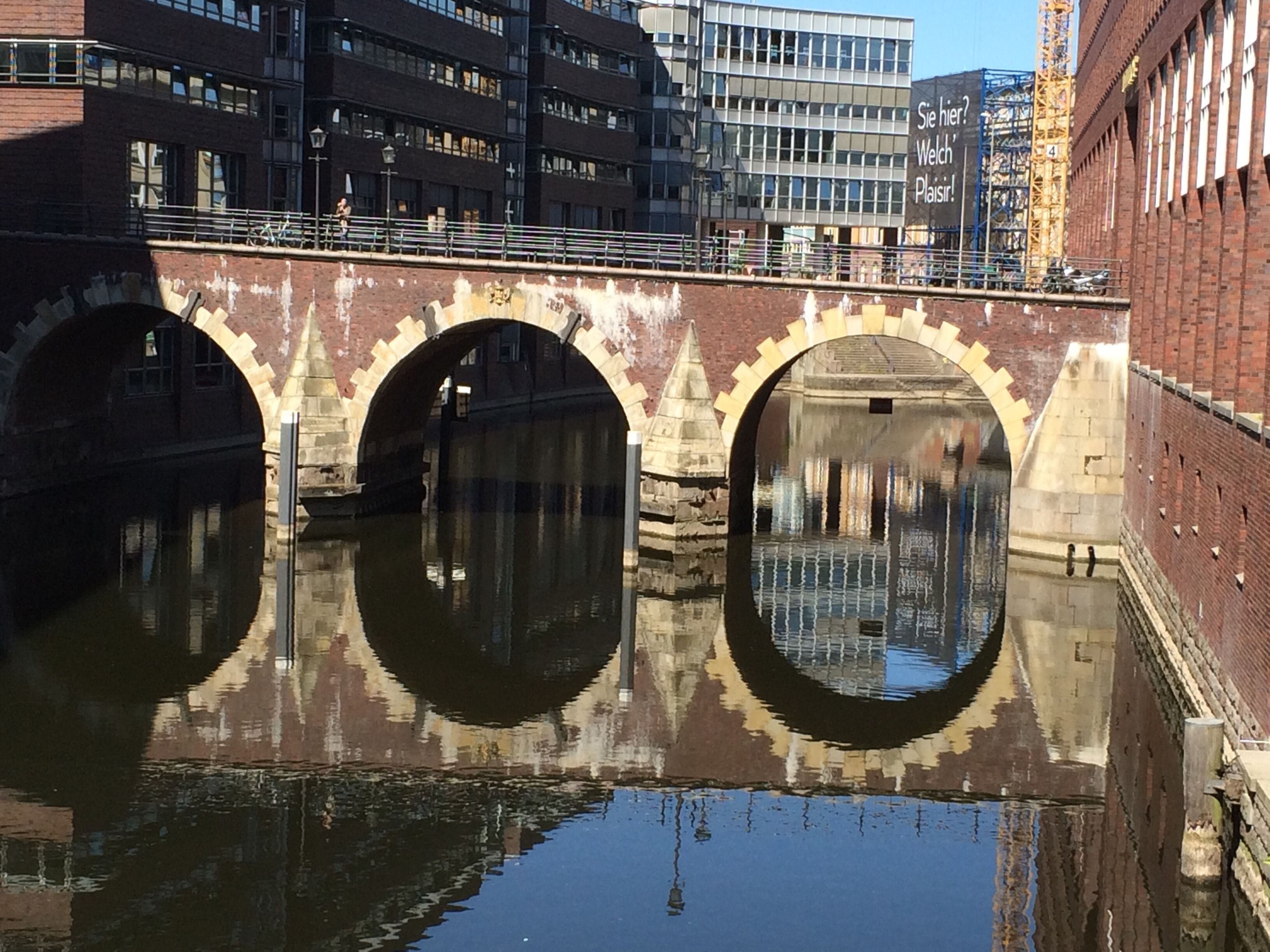 architecture, built structure, building exterior, reflection, water, canal, building, arch, waterfront, city, connection, residential building, residential structure, window, outdoors, bridge - man made structure, river, no people, transportation, standing water