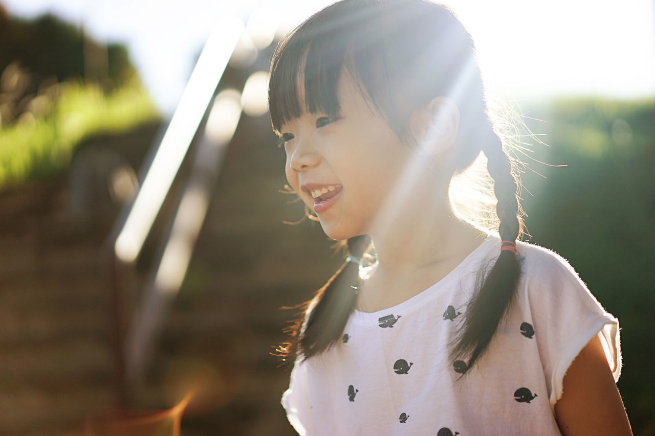 Cheerful Asian Girl Asian Girl Brown Hair Cheerful Childhood Close-up Focus On Foreground Happiness Headshot Kid Morning Sun One Person Outdoors People Smiling Sunlight