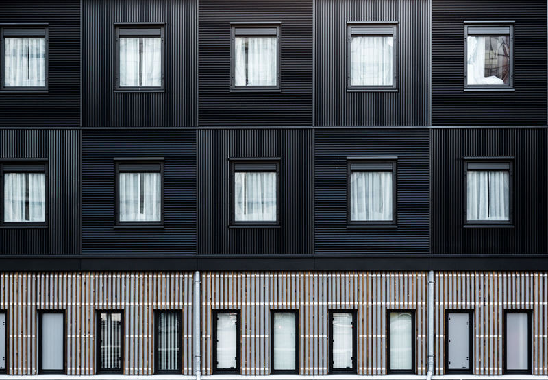 Modern building wooden elevationmade from black colored alternated timbers on London hotel in Docklands Architecture Backgrounds Building Exterior City Colateral Consistency Dark Docklands London Elevation Front Full Frame Geometry Hotel Lines Modern Architecture Outdoors Parallel Pattern Rectangle Square Stripes Pattern Urban Wall Window Windows