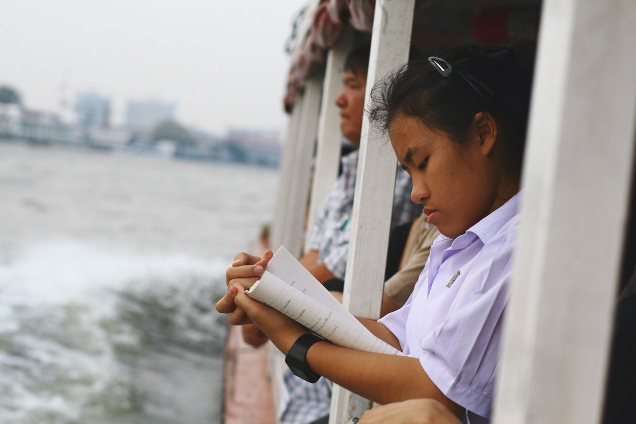 The Human Condition Thailand Reading Books River Boat Bangkok Commuting Commuter On The Way On The Way Home Girl Big City Life ASIA Transportation Asian Culture Education Asian Girl Thai Thai Girl Thai Culture Book
