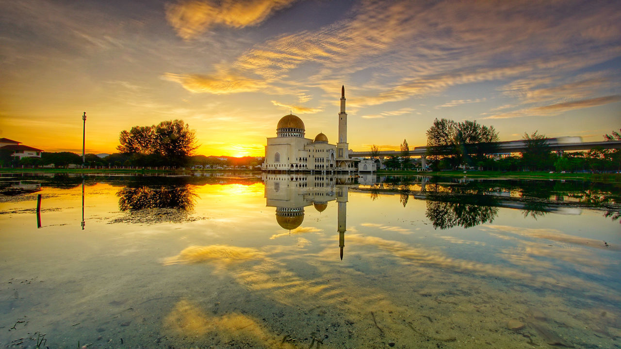 reflection, dome, built structure, architecture, religion, cloud - sky, water, building exterior, sky, place of worship, spirituality, travel destinations, sunset, no people, tree, outdoors, nature, day
