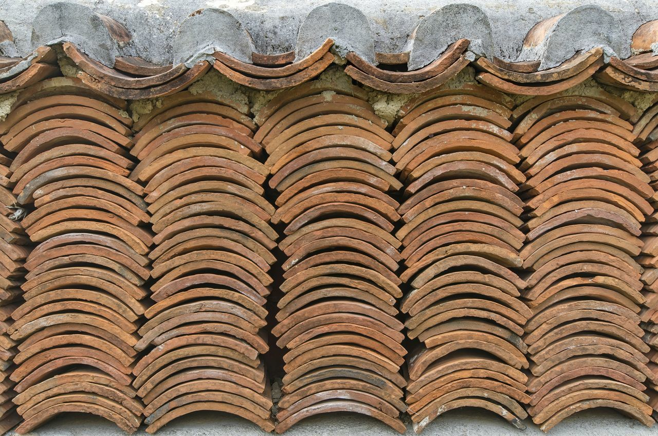 Stack Of Roof Tiles Arranged Side By Side