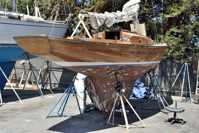 Boatyard @ Berkeley Marine Center 3 Berkeley, Ca. Boat Repair And Restoration Custom Yacht Builder Boatyard Boats On Stands Boat Being Prepped For Painting Hull Keel Sailboat Cabin Masts Sails Tarps Wood Boat Yacht Water Craft Sailboat Not Quite Ready For Water