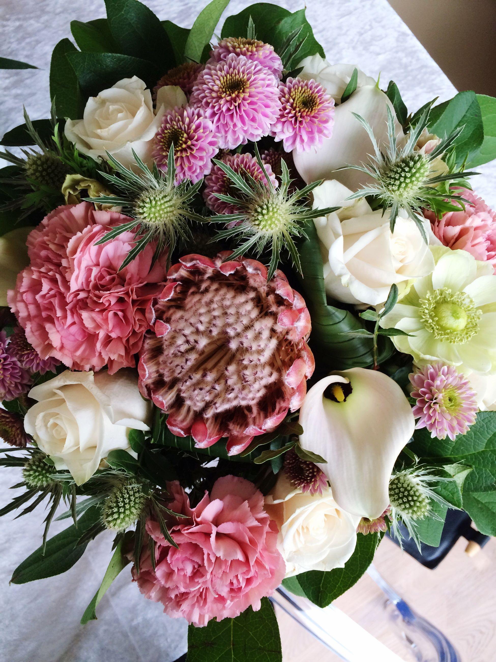 flower, indoors, freshness, still life, decoration, vase, petal, table, bouquet, fragility, bunch of flowers, flower arrangement, close-up, pink color, high angle view, variation, rose - flower, food and drink, food, flower head