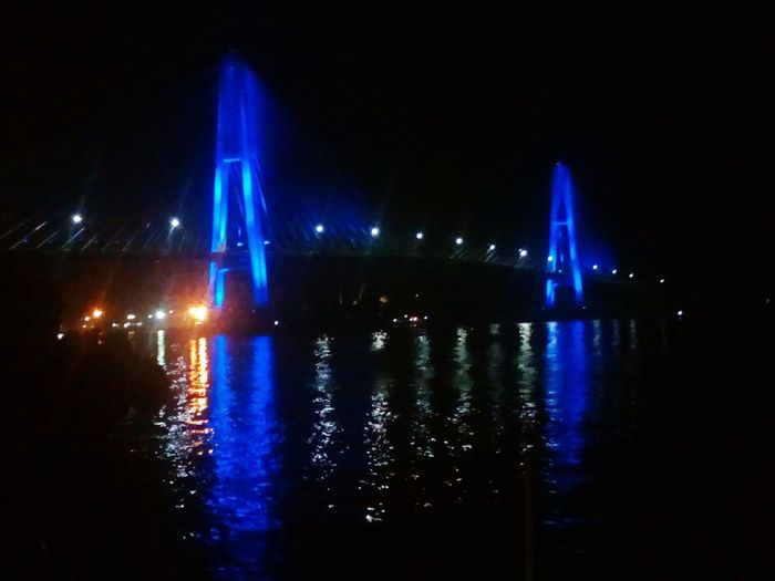 i get long shot this photo, i look lamp can changes for all colour. Indonesia,kaltim,jembatan mahkota ll Place Holiday Colour Your Horizn Horizon Illuminated Night Reflection Light Beam No People Outdoors Water City